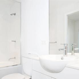 Clear splashback shower door in bathroom